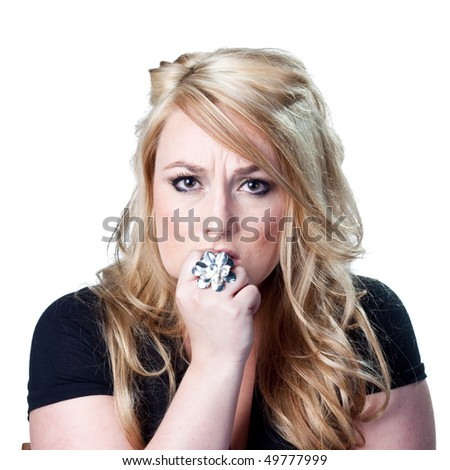 Blond lady deep in thought - stock photo