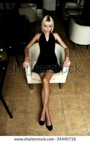 Blond lady in cafe - stock photo