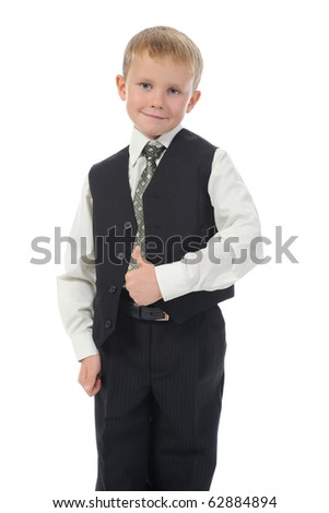 Blond little boy in school suit. Isolated on white background