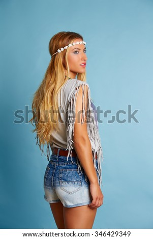 Blond long hair girl with jeans shorts and summer shirt on blue