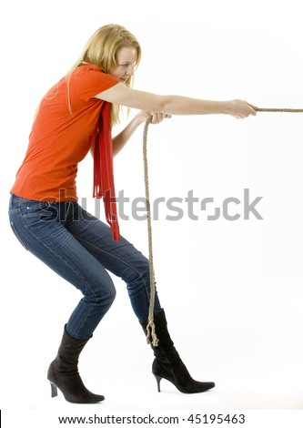 blond, long hair, young woman pulling grey rope, tug-of-war - stock photo
