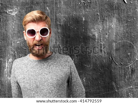 blond man angry expression