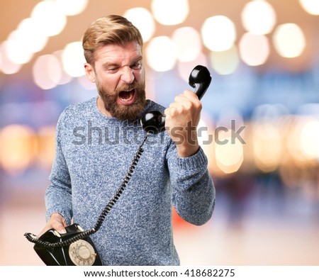 blond man angry expression - stock photo