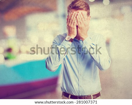 blond man covering face sign - stock photo