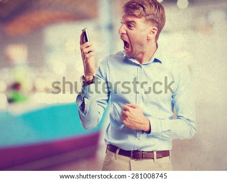 blond man shouting on phone - stock photo