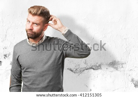 blond man worried expression