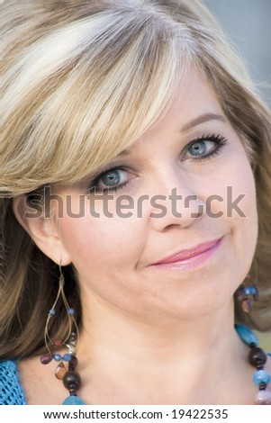 Blond middle-aged woman head shot only - stock photo