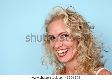 Blond model laughing at you