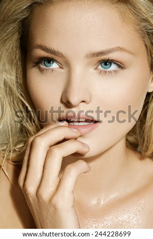 Blond model with wet face. - stock photo