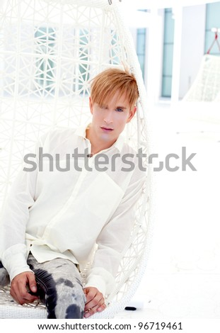 blond modern man portrait in summer terrace vampire inspiration - stock photo