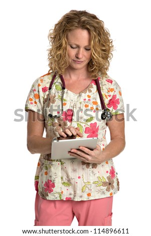 Blond Nurse with Natural Looking Smile Wearing Flower Patterned Scrubs Holding Tablet Computer on Isolated White Background - stock photo