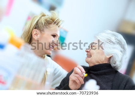 blond personal with senior - stock photo