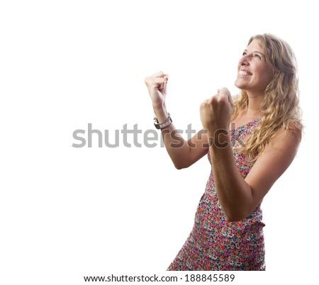blond pretty woman celebrating her success - stock photo