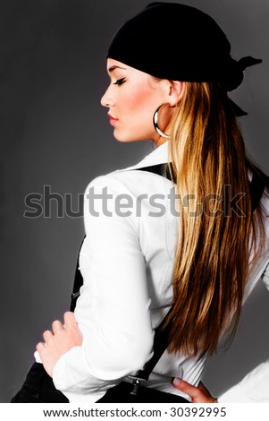 blond pretty woman in white shirt, black suspenders and head scarf - stock photo
