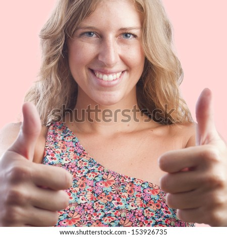 blond pretty woman with all right gestureisolated - stock photo