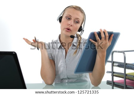 Blond receptionist wearing head-set - stock photo