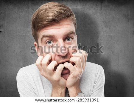 blond scared man - stock photo