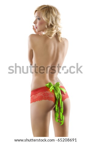 blond sexy girl wearing red panties and showing her ass with a red bow on it - stock photo