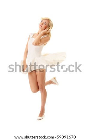 Blond sexy woman in white skirt blowed by wind, isolated on white background