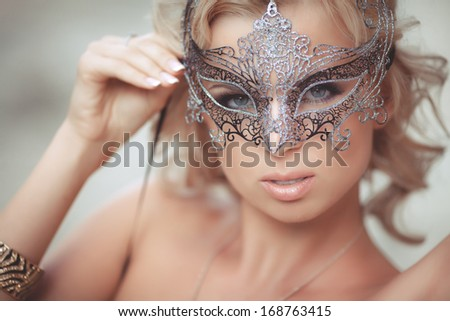 Blond sexy woman portrait in venetian mask. Sensual vogue girl. Fashionable blonde woman. Chic and luxury style. Bright makeup and curly hair. Retro. Jewelry and Beauty. Fashion art photo - stock photo