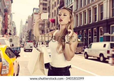 Blond shopaholic tourist girl selfie photo in Soho New York Photomount - stock photo
