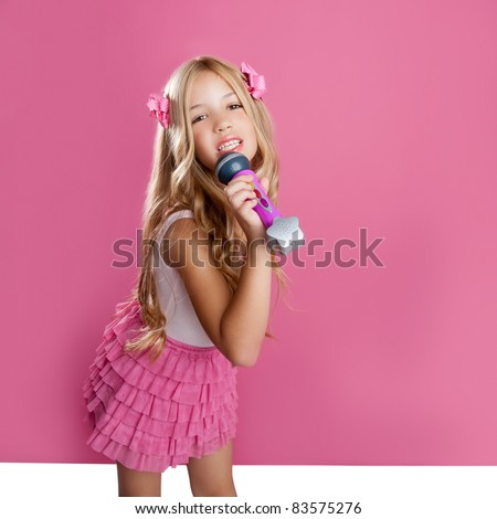 blond singer star girl like fashion doll singing with mic - stock photo