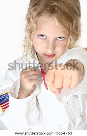 Blond six year old girl doing martial arts - stock photo