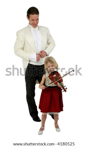 Blond six year old girl plays violin for man in tuxedo - stock photo