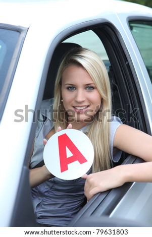 Blond teenage learner driver - stock photo