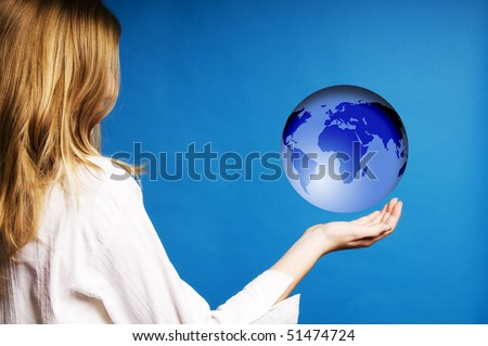 blond teenager girl holding a floating world globe - stock photo
