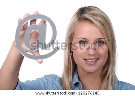 Blond teenager holding metal symbol - stock photo