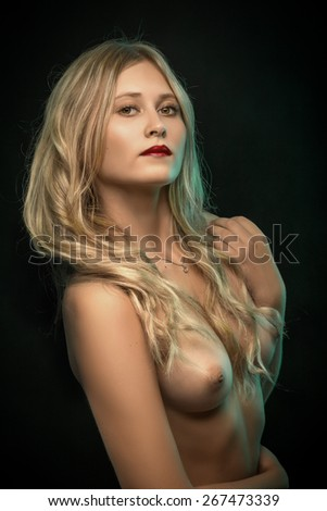 blond topless woman with perfect breast on black - stock photo