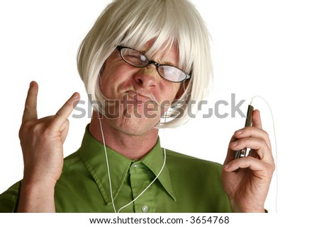 Blond wig on funny man with digital music player. - stock photo