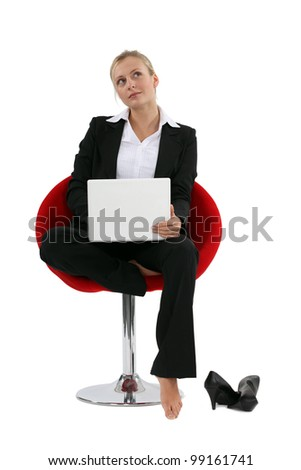 Blond with laptop barefoot - stock photo