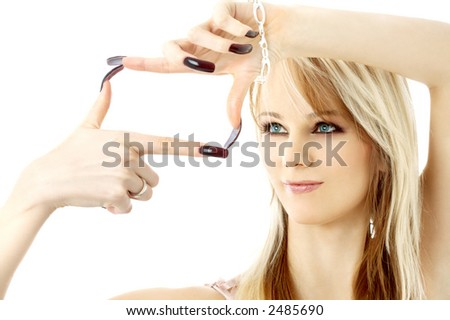 blond with long nails looking through her fingers in a box shape - stock photo