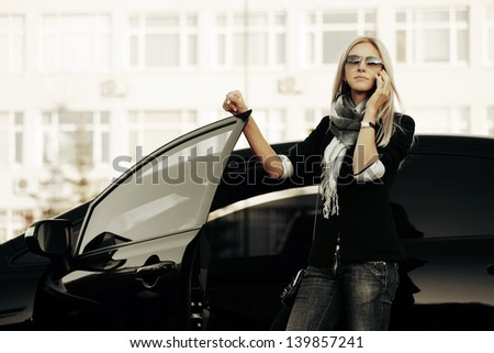 Blond woman calling on the phone - stock photo
