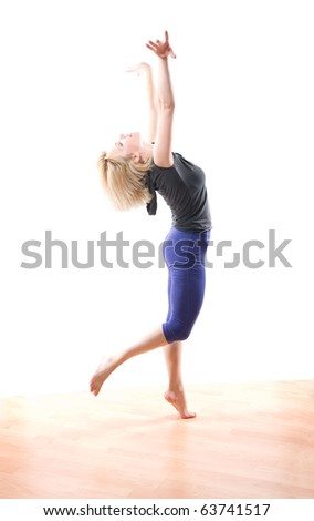 blond woman dancing modern jazz on wood floor