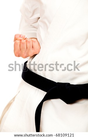 Blond woman doing karate, black belt, isolated on white - stock photo