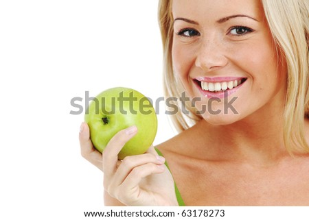 blond woman eat green apple - stock photo