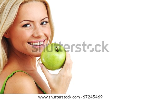 blond woman eat green apple - stock photo