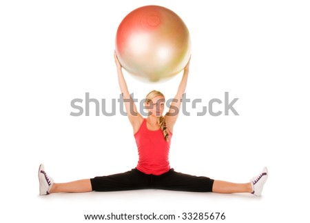 Blond woman exercising with a pilates ball
