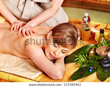 Blond woman getting aroma massage in spa. - stock photo