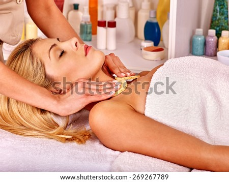 Blond woman getting head massage. - stock photo