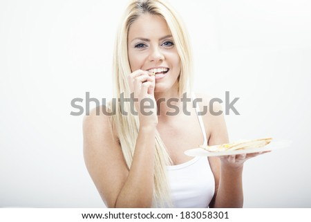 blond woman having breakfast in bed - stock photo