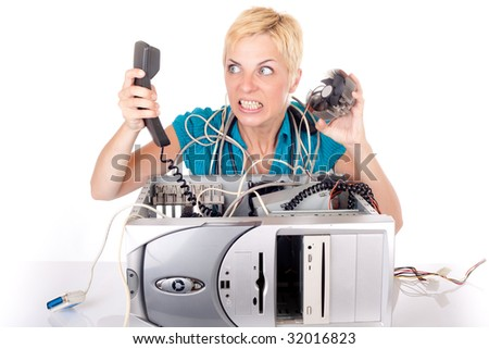 blond woman having problem with computer yelling at support on phone - stock photo