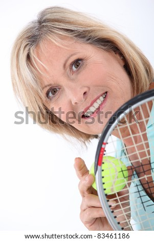 Blond woman holding tennis racket and ball - stock photo