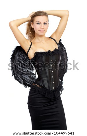 Blond woman in black lingerie with angel wings posing in the studio - stock photo