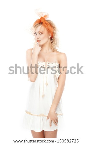 Blond woman in dress posing on a white background - stock photo