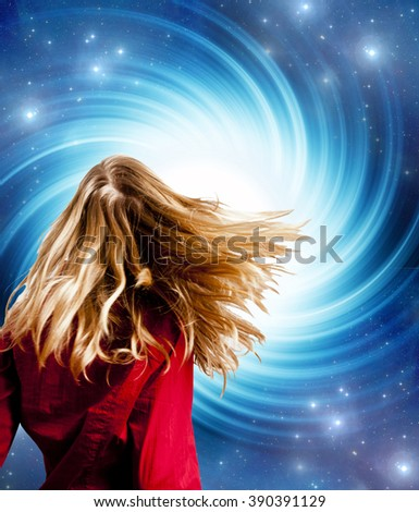 blond woman in front of a swirling space concept for astrology and mystical - stock photo