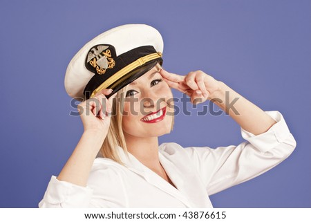 blond woman in generic officers cap saluting - stock photo